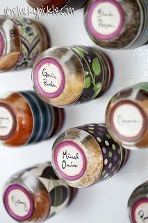 Baby food jars repurposed into magnetic spice jars.  Also a great idea for craft room beads and notions!