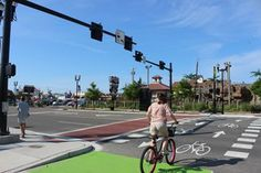 A bicyclist at the intersection of Ninth Street and Haven Avenue where a HAWK signal was recently installed.