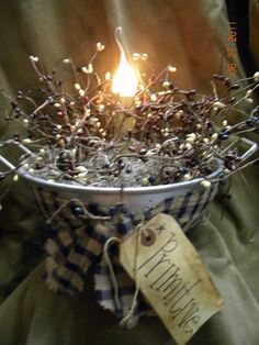 Your grannies colander never looked so good. The colander is filled with moss and pip berries and has an electric candle in the middle. A Primtive tag is attached with a homespun fabric bow. Extra long cord with an on/off switch. With bulb it is 10 inches tall and 12 inches wide.$15.00