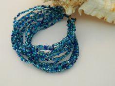Crochet cobweb Cuff Bracelet Blue seed beads and by uniquenique, $28.00 #handmade #onfireteam #teamfest #jewelry #bracelet #accessories