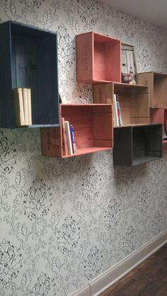 These are repurposed wine crates screwed to the wall as bookshelves.