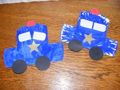 Police cars made from paper plates, paint and cardstock.
