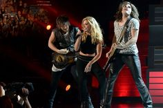 Musicians Neil Perry, Kimberly Perry and Reid Perry of The Band Perry perform onstage during the 49th Annual Academy Of Country Music Awards