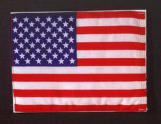 "This flag was included in the special ""gift bag,"" in which several exchange items were carried aboard the Apollo command module during the joint US-USSR Apollo-Soyuz Test Project mission."