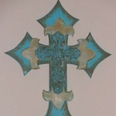 Real and cream distressed layered wooden cross.