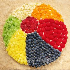 This is a beach ball fruit pizza.  Fun to make for a day at the beach or a back yard pool party!