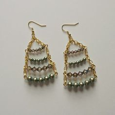 Looking for a cute and easy pair of DIY earrings? Learn how to make earrings that look like sparkly ladders, or possibly even festive Christmas trees depending on what beads you choose.
