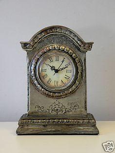 Antique silver mantel clock