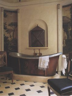 Interesting design with copper & nickel vessel tub, and trompe l'oeil views...