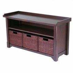 """Storage bench with an open shelf and 3 removable baskets.   Product: Storage bench   Construction Material: Wood and wicker   Color: Walnut    Features:  One shelf   Three baskets included      Dimensions: 22"""" H x 40"""" W x 14.2"""" D"""
