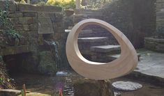 Jim Milner sculpture - geometric stone sculpture Mobius III - we love these and what a garden!