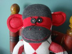I sooo want to make one of these soon... They are sooo cute... #sockmonkey #red #black #white #argyle