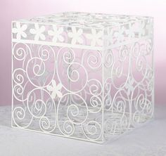 This white metal card box features a daisy and scroll pattern making it a perfect choice for a spring theme or outdoor wedding.
