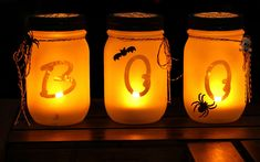 A perfect way to light the path to your front door on Halloween night, these frosted luminaries can be made with alphabet stickers and glitter blast spray paint.