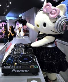 Sanrio's Hello Kitty DJs for the opening of a new shop called Club KT, in Tokyo.