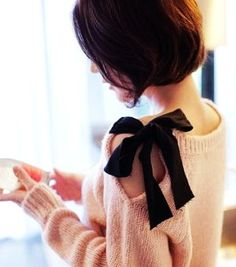 Take an old sweater. Cut a slit in along the shoulder down about 7in. Fold over raw edge and sew in place. Sew a piece of ribbon about 15in long to one side of neckline and another ribbon to the other side of the neckline. Tie together!