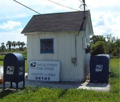 AMERICA'S SMALLEST  POST OFFICE  Ochopkee, FL.  Located in the middle of the Everglades, this former  pipeshed has been a U.S.  post office for 54 years.