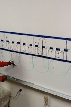 Use painter's tape on a dry erase board for kids to practice their handwriting.