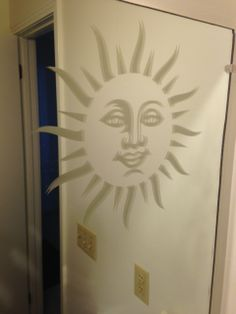 Custom sun decal from www.DecalJunky.com cut from etched glass material and applied to a mirror. Etched glass decals look great on mirrors, patio doors, and windows!