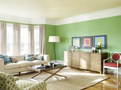 Choosing Family Room Color: Contemporary living room with green wall and white sofa