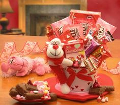 Monkey Love Gift Pail    Don't monkey around this Valentines Day -   send your sweetheart the Monkey Love Valentines Gift Pail. This plush hanger monkey delivers a white Valentines pail filled with Valentine sweets for your sweetheart. Send the Monkey Love Valentines Gift Pail to your Valentine!  SHOP NOW: www.KimsLabellabaskets.com