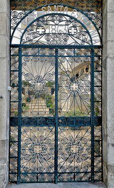 cats, cat man, wrought iron gates, garden gates, lar de, window treatments, iron doors, santa estefania, de santa