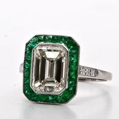 sigh, emerald cut with emerald halo.