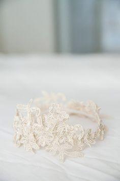 lace garter, photo by Adene Photography http://ruffledblog.com/nature-inspired-wedding #weddingaccessories #weddinglace