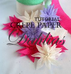 Crepe paper dahlias are a great way of saving those pieces of paper and ribbon you might have around your craft room or studio.  You can wear them as a funky brooch, as a spring decoration, as a gift topper...