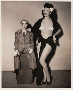 A stripper ventriloquist, whose vent figure appears to be a businessman on holiday??