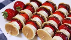 Mini pancakes with Nutella, bananas, and strawberries are skewered on a kabob stick for a fun and easy breakfast (or anytime) snack.