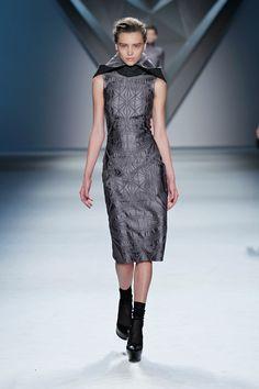 Steel vault jacquard sleeveless sheath dress with oversized detachable charcoal melton hood.