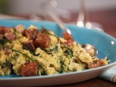Bobby Flay Creamy Scrambled Eggs with Dill Havarti with Country Ham and Buttery Toasted Croutons from CookingChannelTV.com