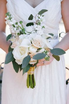 White bridal bouquet // see more: http://theeverylastdetail.com/modern-black-and-gold-wedding-ideas/