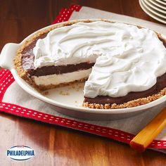 Sweet, whipped cream cheese, decadent chocolate pudding, and a Cool Whip topping? This must be heaven. Serve this Mud Pie after dinner for the perfect finale.