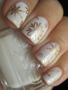 Gold Snowflake Nails with White Base |