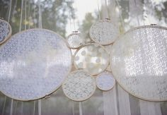 Insanely easy to do, hang with fishing wire. Bonus idea for rustic glam: spray paint the hoops a metallic color.