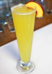 The Best Bellini Ever with Peach Vodka, ripe peach, agave nectar, fresh lemon juice, and prosecco.