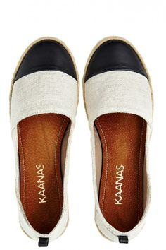 Marsei Espadrille  Marsei Espadrille $115.00      Description     Details & Fit     Fabrication     Contact Us      By KAANAS SHOES -     Step into spring with chic simplicity! These handcrafted color block espadrille slip-ons are the perfect neutral addition. Ivory brush cotton is paired with black leather for a striking contrast in texture and tone. Jute wrapped mid-sole is finished with a texturized rubber outer sole for casual comfort.