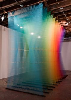 Plexus No. 4 by Gabriel Dawe consists of more than 50 miles of thread strung up on wooden planks to form floating, rainbow-colored veils