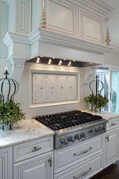 Well-dressed Traditional Kitchen   tile backsplash, hood design.