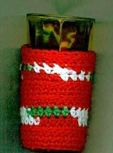 Charming Christmas Cozy - Your drink will stay nice and warm when wrapped up in this crocheted cozy. Spread Christmas cheer by giving these as holiday gifts this year.