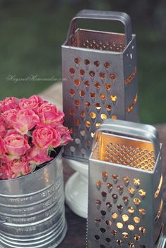 I have a bunch of flour sifters - never thought to put flowers in them...tried the vintage graters with candles and they look great, but get VERY hot! Keep them away from pets and little fingers :)