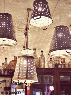 Repurposed metal Olive Bucket as light fixtures (at Brimfield in Chicago). #retail #merchandising #lighting #repurpose