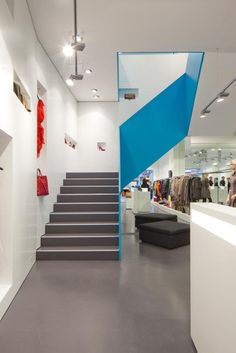 beautiful staircase in Inside fashion store by Söhne & Partner Architekten, Vienna