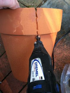 Great how-to on creating a Fairy Garden in a broken pot. Cutting the terra cotta pot with a dremel and carbide tip