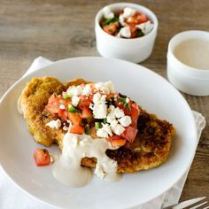 This crisp spiced chicken is served with a salad of tomato, feta cheese, jalapeño and parsley.