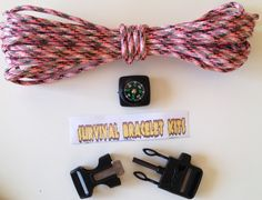 Fire Starter Buckle Bracelet Kit with Compass Pink Camo No one plans to get lost or to be in a survival situation unless you are Les Stroud or Survivorman. Unexpected things happen where you can get lost on a hike or flip your canoe and have only the clothes on your back. If you are wearing one of these survival bracelets you will have the ability to start a fire with the fire starter buckle, 20 feet of paracord 550, a whistle, and a compass.