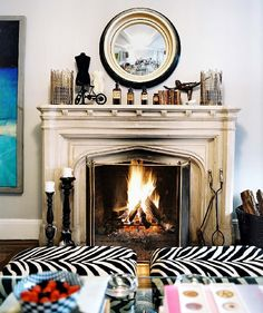 fireplace, accessories, zebra ottomans!
