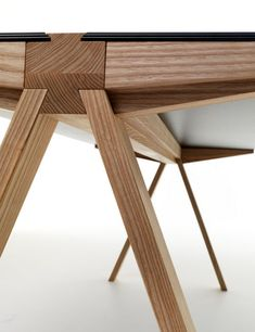 The Traverso Table by Francesco Faccin. Beautiful wood detailing.
